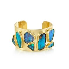 Rpnd. from Jesurang Morita. Stunning modern design of Opal and gold in a cuff. I'd spend the night alone in a haunted house for this bracelet.