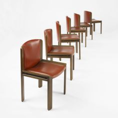Joe Colombo; Walnut and Enameled Steel 'Modello 300' Dining Chairs for Pozzi, 1965.