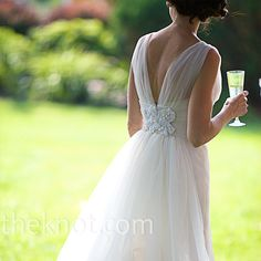 Wanting her dress to feel light for the garden venue, Susan chose this V-neck gown by Christos with an appliqué on the back and layers of airy tulle.