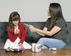 Just try it! A new video has parents explain peer pressure to their children, and many of them do so by jokingly offering cigarettes and beer to their kids