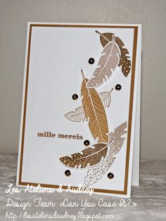 hand crafted card from The Audrey Workshops ... stamped and die cut feathers tumble down the card ... monochromatic ... great card!