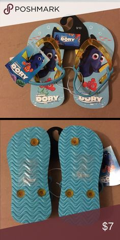NWT Disney Pixar Finding Dory Blue Flip Flops 9/10 NWT toddler girls blue Disney Pixar Finding Dory Flip Flops are size 9/10. Straps are clear orange color and back straps are blue elastic. Design is Dory and Nemo swimming. Made in China of man made materials. Disney Shoes Sandals & Flip Flops