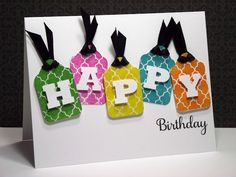 handmade birthday cards ... bright tags with die cut letters spelling HAPPY ... birthdy in script stamped below ... clean lines ... lovely card ...