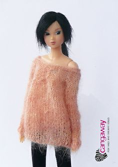 Momoko wears a sweater from Cangaway's Winter Collection.