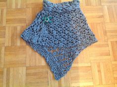 Crochet experiment. Roll-neck cape, shorter at front, longer at the back.