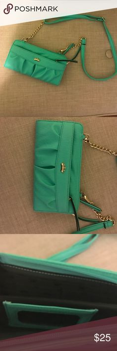 Teal and gold juicy small purse Small teal juicy purse.  Straps can come off to make a clutch.  Never used. Juicy Couture Bags