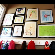 Front hall: Kids artwork display and coat hooks in yellow room above the bench. Displaying Kids Artwork, Artwork Display, Cool Artwork, Frame Display, Display Ideas, Kids Art Galleries, Wall Galleries, Wall Collage, Wall Art