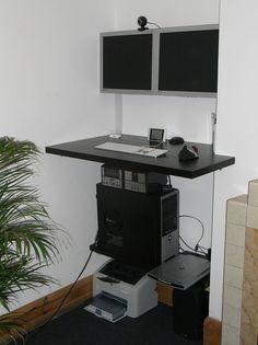 Dual monitor standing desk. All shelves.