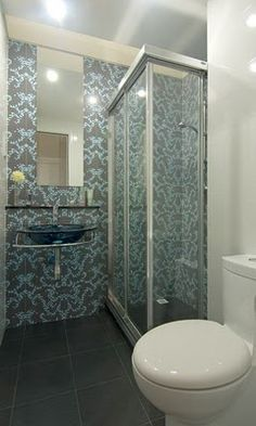 love the look of this small bathroom? Cool wallpaper!