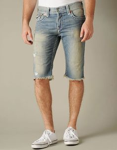 MENS RICKY SUPER T CUT OFF SHORT $298.00  Prepare for summer in this converted warm weather style by True Religion. Our popular straight leg Ricky features gets updated with a cut-off hem for...
