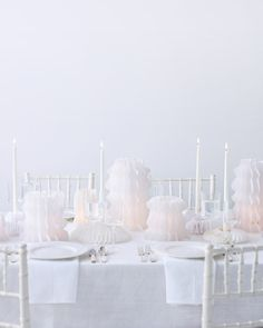 Pop-up paper lanterns cast an ethereal glow on tables. How'd we make them? By repurposing tissue paper fans.