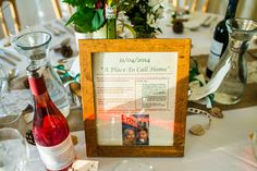 Table Names with dates & stories from the Bride & Grooms past - Image by Navy Blur - Bride in lace wedding dress & shoes with dried flower headpiece. Groom wears tweed suit & bow tie & bridesmaids in mis-match dresses for a castle, vineyard & rustic marquee wedding with autumnal colour scheme.