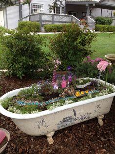 Fairy garden in an antique claw foot tub