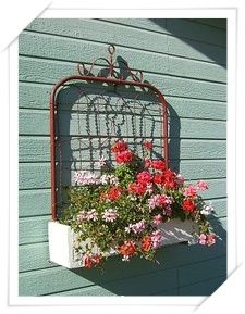 Darling faux window box using an old rusty gate.