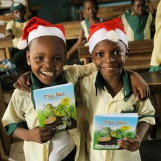 2 friends smiling  after given free books to read #jumia #1child1book #kaykluba #purplecrib #lagos