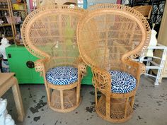 Item No.: 9848 Inquire About This Item  Info: VINTAGE Pair of Wicker FAN Chairs with newly upholstered seat cushions in good as found condition. There is minor wear to the finish and a few breaks in the wrapping. (see photos) Dimensions (in inches): Height: 59 Depth / Diameter: 23 Width / Length: 42 Seat Height:  Maker: Wicker Price: $1200 / pr