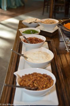 Toppings!  Proof's Potato Bar Garlic potato mash, herb butter, sour cream, chives, bacon bits, cheddar cheese  Smashed sweet potatoes, whipped butter, brown sugar mini marshmallow + chopped spiced pecans
