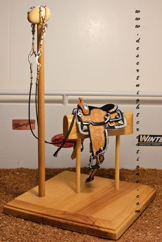 Miniature western Pleasure Saddle set finished after four years.. Saddle has real silver plates and all of the leather has been hand tooled by me.
