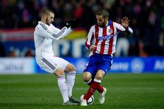 Karim Benzema (L) of Real Madrid CF competes for the ball with Mario Suarez (R) of Atletico de Madrid during the Copa del Rey Round of 16 first leg match between Club Atletico de Madrid and Real Madrid CF at Vicente Calderon Stadium on January 7, 2015 in Madrid, Spain.