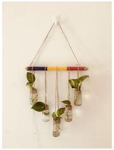 DIY glass bottle wall planter #glass #bottle #planters #diy #glassbottleplantersdiy Plants In Bottles, Small Glass Bottles, Glass Bottle Crafts, Diy Bottle, Hanging Glass Planters, Wall Mounted Planters, Diy Planters, House Plants Decor, Plant Decor