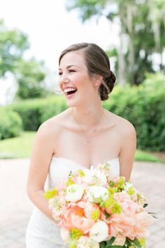 Her wedding has her all smiles: Wedding Dress: Monique Lhuillier - http://www.stylemepretty.com/portfolio/monique-lluhillier Photography: Amalie Orrange Photography - amalieorrangephotography.com   Read More on SMP: http://www.stylemepretty.com/2016/09/01/romantic-military-florida-summer-wedding/