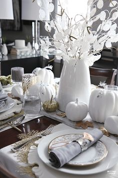 Gold ginkgo leaves, oak leaves, pumpkins and natural elements are used to create this elegant holiday table. See how to entertain in style - and decorate a table for less!