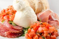 Fresh Burrata, Prosciutto, salami Milano, tomatoes, basil & a hot Ciabatta from the oven @ Funky Lounge