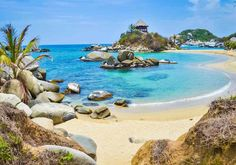 A trip to Columbia, South America might be in order so you can visit Tayrona National Park. It is one of Columbia's most famous national parks and features flourishing rainforests, sandy beaches and arid lands. A must visit for all beach lovers. Trip To Colombia, Colombia Travel, Columbia South America, Tayrona National Park, America Images, Nevada Mountains, Visit Santa, Santa Marta, Sunny Beach
