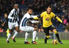 Roberto Pereyra of Watford and Matt Phillips of West Bromwich Albion compete for the ball during the Premier League match between West Bromwich Albion and Watford at The Hawthorns on December 3, 2016 in West Bromwich, England.