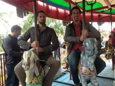 Zachary Levi looking super manly... on a carousel. Love it!