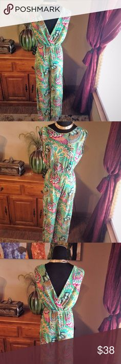 Boho women's jumpsuit peacock feather print Fashion women's flowy jumpsuit peacock feather printing boho  never worn like new no brand tag  Size M does stretch  No tag so I'm not sure which is the front or back it look like it can be worn either way so cute  Waist band  waist 11' stretched 19', pit-pit 16.5-17', inseam 30', length top to bottom 56' no trading or modeling can not fit Pants Jumpsuits & Rompers