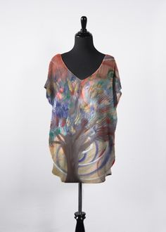 Artist Kelly @ MessiahsDisciple COLOR TREE Essential Top This beautiful, flowing top features dolman sleeves, a flattering V-neck and a hi-low silhouette. It will be your new go-to top this season and all year long! Pair it with your favorite tapered pants or skinny jeans for an effortless, day-to-night look. NOTE: Each piece is uniquely designed and custom-printed. Color and placement of artwork may vary upon receipt. 85.00 USD http://shopvida.com/collections/voices/products/color-tree-top