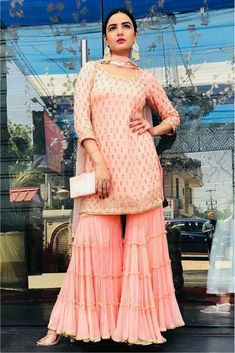 Youdesign Georgette Multi Work Gharara In Pastel Pink ColourSha ra ra in sharara, earrings a😍The Stylish And Elegant Gharara In Pastel Pink Colour Looks Stunning And Gorgeous With Trendy And Fashionable Georgette Fabric Looks Extremely Attractive Sharara Designs, Kurta Designs Women, Kurti Designs Party Wear, Indian Fashion Dresses, Dress Indian Style, Pakistani Dress Design, Pakistani Dresses, Pakistani Suits, Indian Wedding Outfits