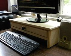 Etsy | Computer monitor stand with drawer for extra storage and hidden hole in drawer back for cell phone chargers