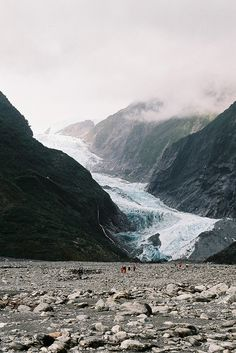 Franz Josef Glacier. one of 4 glaciers in rain forests in the world - people can only just be seen.
