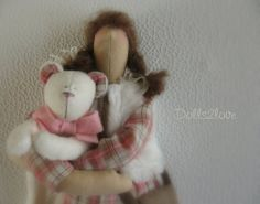 Tilda doll Romy wearing a pink checkered dress accompanied by her little teddy bear. Made by Dolls2love on Etsy, €42.50