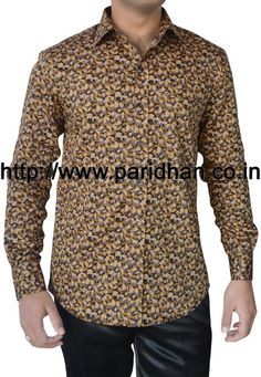 Stylish look mens shirt made in multi color printed cotton fabric.