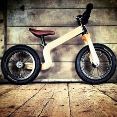 """The Early Rider Lite Wooden Balance Bike: 12"""", Wood - Total Weight: 7.17lbs/ 3.25kgs - Features 12"""" wheels with pneumatic tires - Dual steering system (restricted and unrestricted) - Adjustable reach"""