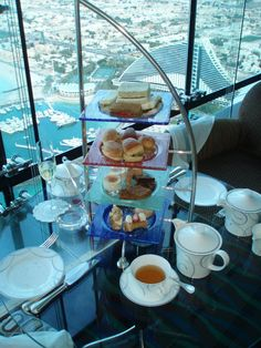 BURJ AL ARAB AFTERNOON TEA Located on the top floor of #BurjAlArab Jumeirah, Skyview Bar instantly matches expectations with unrivalled views of the Palm Jumeirah and The World islands; is inviting you to experience a magnificent afternoon tea. http://buff.ly/1ODaPTS