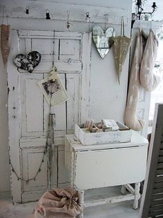 A Shabby Moment in Time: Salvaged door and vintage table - painted white.