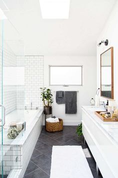 Modern bathroom renovation -- white subway tile and darker grout Laundry In Bathroom, Bathroom Renos, Bathroom Flooring, Bathroom Interior, Bathroom Renovations, Bathroom Grey, Bathroom Goals, White Bathrooms, Dark Floor Bathroom