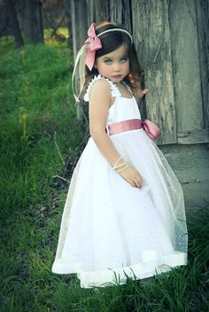What a cute little girl! Love this dress too...