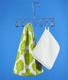 Belt Hanger as Pot Holder/Kitchen Towel  Organizer - I think I'd either hang this on the inside of a cabinet door or on the side of the refrigerator with a magnetic hook...
