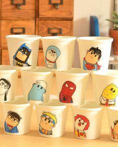 Superhero mugs (I spot Batman, Doremon, Superman, a Smurf, Spiderman, Sponge Bob, Naruto, and Ronald McDonald, at the very least.)