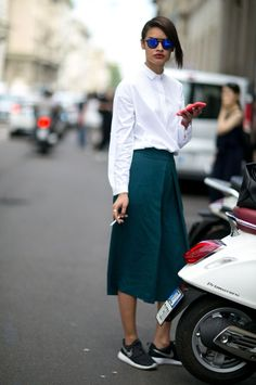 Minimal White Blouse with Green Skirt, shot in Milan.