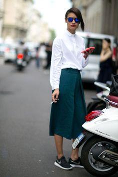 Minimal White Blouse with Green Skirt, shot in Milan.