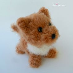 Here's a free Eevee amigurumi pattern to crochet that's so foxy and cute! This Eevee Pokemon amigurumi has a unique design that allows her to sit or stand. Crochet Lion, Crochet Amigurumi Free Patterns, Cute Crochet, Crochet Toys, Fluffy Dogs, Stuffed Animal Patterns, Crochet Projects, Brushing, Knitting