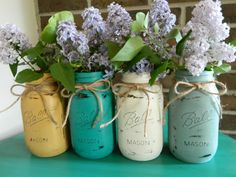 A lovely set of mason jars painted in Arles, Florence, Old White, and Duck Egg Blue Chalk Paint® decorative paint by Annie Sloan... perfect Spring project to hold those early bloomers!