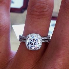 Perfect shape for the diamond..cushion cut is by far my favorite! Not a fan of the band though, I'd like it plain and the whole thing in gold probably.