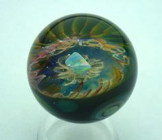 Implosion marble with Gilson opal.